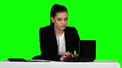 Young businesswoman overwhelmed by too much work in office. Green screen Stock Footage