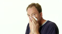 Sick Man Blowing Nose In Tissue Stock Footage