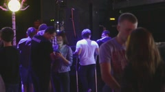 Teenagers stay in nightclub. Preparation before live concert. Spotlights. Dating - stock footage