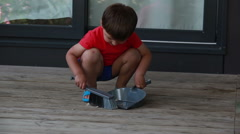 Boy collects the garbage in a scoop Stock Footage