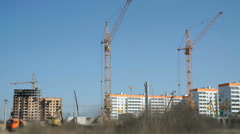 Four construction crane, excavator, truck. Working Stock Footage