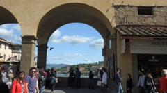 Tourists on scenic and romantic Ponte Vecchio, Florence, Italy Stock Footage