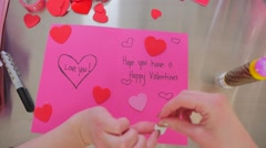 A Female Creating A Happy Valentines Day Card With That Says Love You - stock footage
