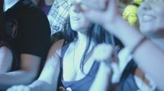 Young girl rhythmically dance in nightclub. Spotlights. Man brings beer. Girl Stock Footage