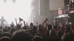 People clap on live concert in nightclub. Spotlights. Axe, balalaika. Bear, two - stock footage