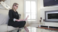 Revealing A Young Female Business Entrepreneur Typing On Her Laptop Computer Stock Footage