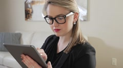 Revealing A Young Business Entrepreneur Pressing And Swiping Across Her iPad - stock footage