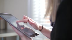Young Blonde Female Inside Pressing On Her iPad Tablet Close Up Stock Footage
