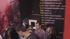 Young people stay in line on stairs to live performance in nightclub. Spotlights - stock footage