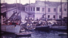 3276 boat docks in Bahamas are full of fishing boats - vintage film home movie Stock Footage
