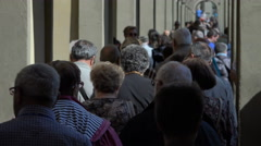 Elderly tourists, anoymous, group, defocused - stock footage