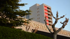 Health Care Hospital Sign And Modern Building Exterior Stock Footage