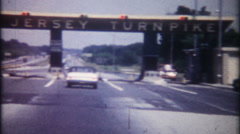 3278 cars approach toll booth on the New Jersey Turnpike-vintage film home movie - stock footage