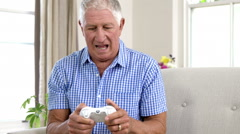 Smiling old man playing video game Stock Footage