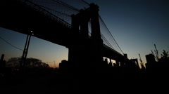 Brooklyn bridge silhouetted establishing shot at sunset Stock Footage