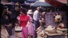 3277 tourist shop for hats at the island bazaar - vintage film home movie Stock Footage