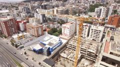 Rotating around a Construction Crane in Quito Stock Footage