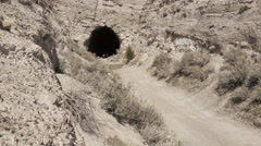 Side by side off road vehicle emerges from tunnel Stock Footage