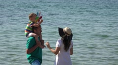 Beautiful family, young parent and sweet child at seaside Stock Footage