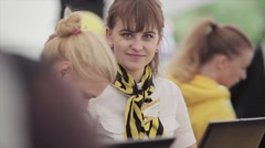 Girl in black and yellow shawl smile, wave hand in camera on summer festival - stock footage