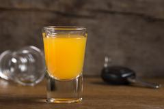 Car keys with one shot glasses - stock photo