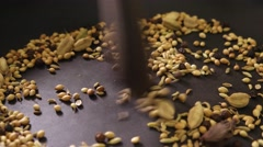 Close up of raw spices being prepared in a pan for Indian curry Stock Footage