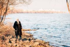 Woman Close to the River in Winter Stock Photos