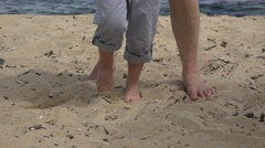 Mother and son barefoot walking on sand, summer holiday, seashore Stock Footage