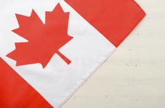 Canadian red maple leaf flag on white wood background. Stock Photos