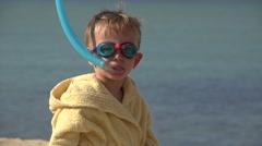 Sweet child portrait trying snorkeling equipment, amusing boy with bathrobe - stock footage