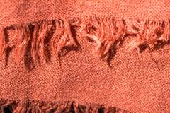 Textile background terracotta color with fringe close up Stock Photos