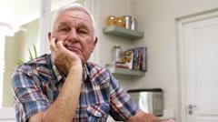 Sad old man thinking in kitchen Stock Footage