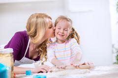 Lovely mother kissing worth daughter Stock Photos