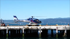 Tourist helicopter takes off from wharf. Stock Footage