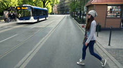 Young, hipster woman crossing street, super slow motion 480fps Stock Footage