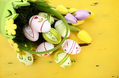 Easter background on yellow wood - stock photo