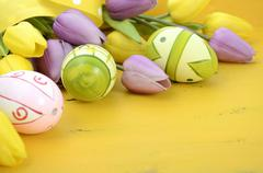 Easter background on yellow wood Stock Photos