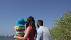 Little child and young parents on the beach, plane passing over heads,say hello  Stock Footage