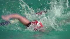 Junior champion swimmer. - stock footage