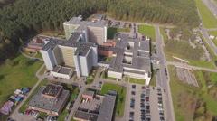 Establishing shot, big modern building may be headquarters, hospital, etc aerial Stock Footage
