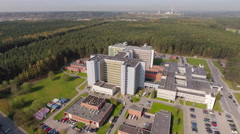 Establishing shot, big modern building may be headquarters, hospital, etc aerial Stock Footage