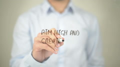 Aim high and Create Action, Man writing on transparent screen - stock footage