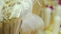 Candles with feathers and petal, dynamic change of focus Stock Footage