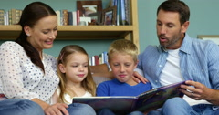 A happy family is reading a book Stock Footage