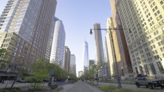 Establishing vehicle shot of New York's World Trade Center during the spring - stock footage