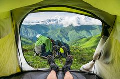 View from inside a tent on the snow-capped mountains in Georgia (Svaneti) - stock photo