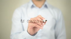 Be Conscientious, Man writing on transparent screen Stock Footage