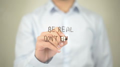 Be Real Don't Fake, Man writing on transparent screen - stock footage