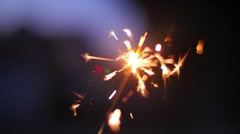 Sparkler burning outdoors at night party Shallow DOF Abstract background Stock Footage