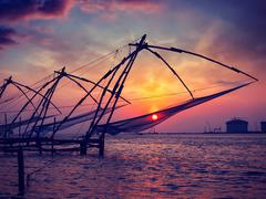 Chinese fishnets on sunset. Kochi, Kerala, India - stock photo